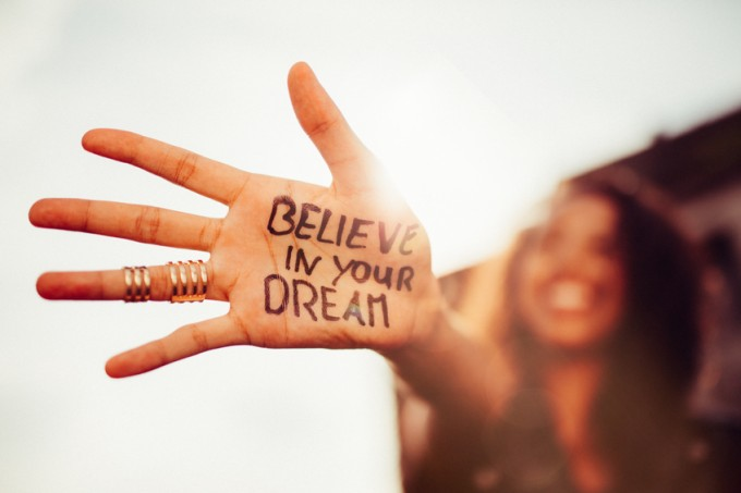 """Girl's hand with """"Believe in your Dreams"""" written on it"""