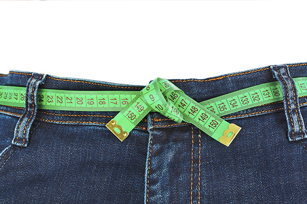 Jeans and measuring tape – slimming concept