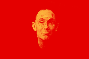 Foto de Gibson, de cabelo curto e óculos redondo.