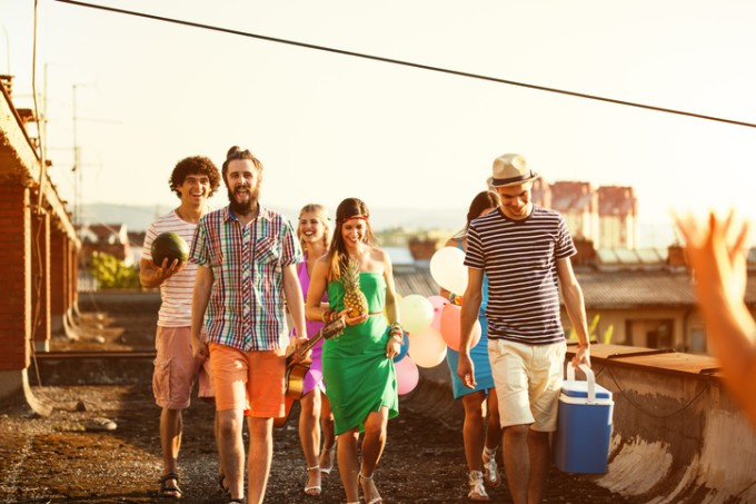 Group of friends coming to rooftop party