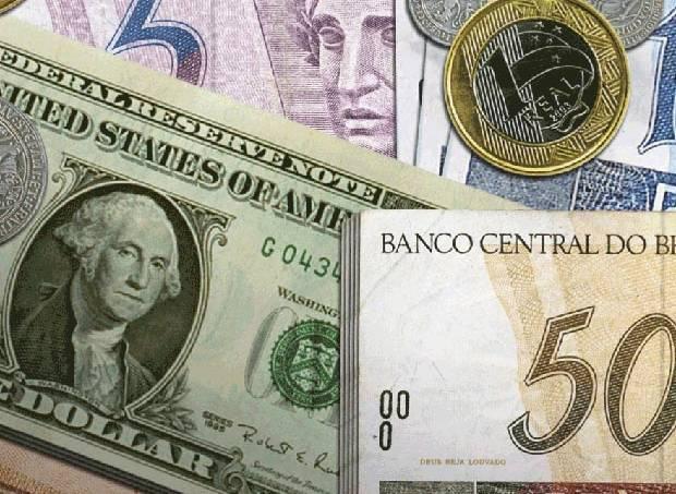 51a50ab098276857bd00024edinheiro-dolar-real-moedas.jpeg
