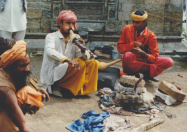 525319cf865be24952001540fakir_with_a_flute_and_snake_india.jpeg