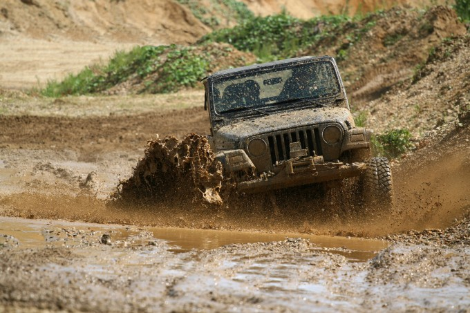 4×4 offroad vehicle driving in mud