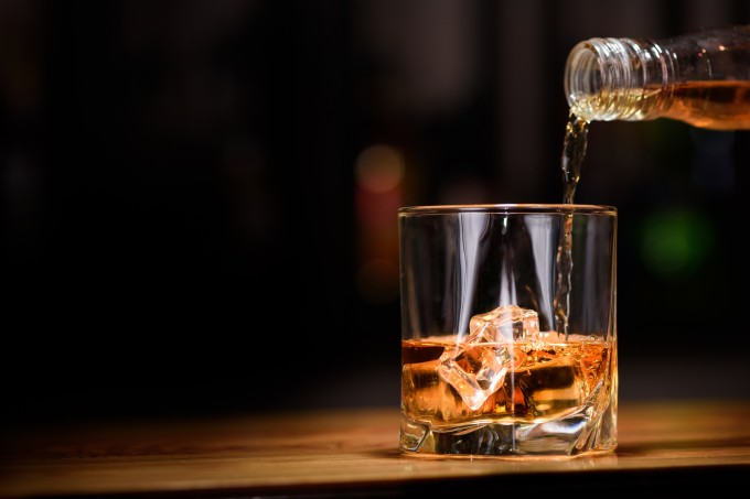 Still life. pour or whiskey in to glass