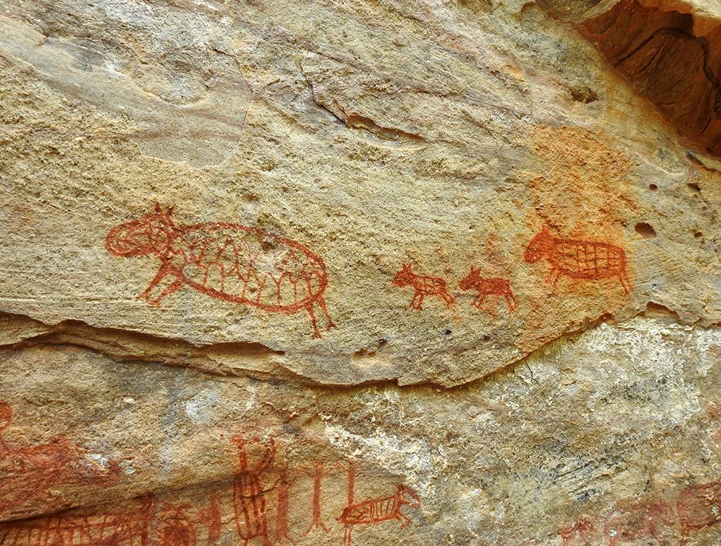 Pintura mostrando uma família de capivaras
