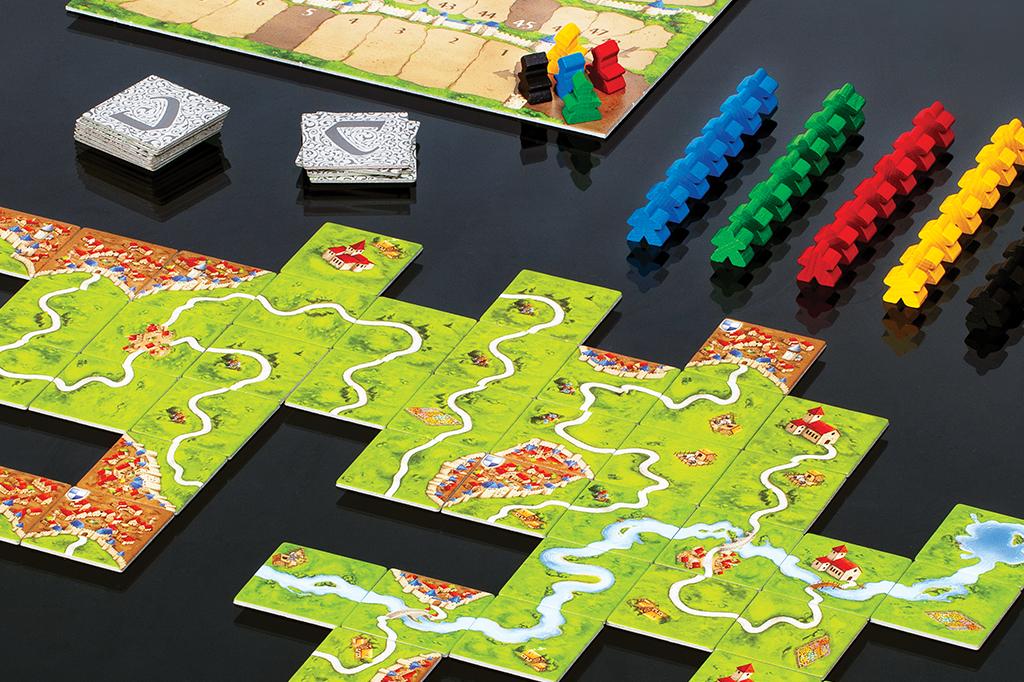 Carcassonne: Este jogo de construção se passa na Idade Média. O nome vem de uma cidade fortificada no sul da França.