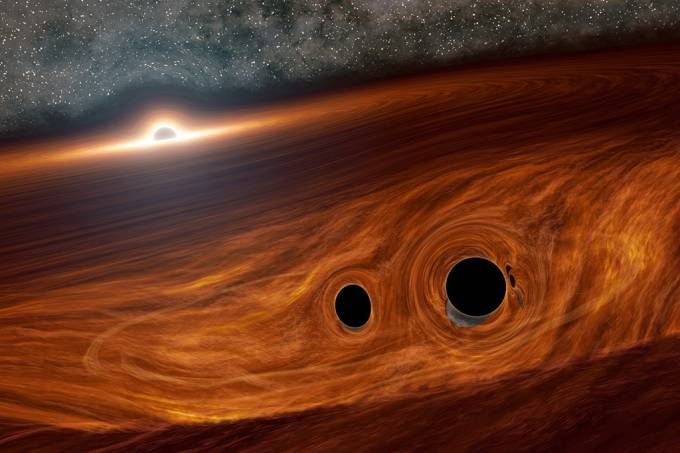 Três é demais: uma dupla de buracos negros colidiu na órbita de outro buraco negro