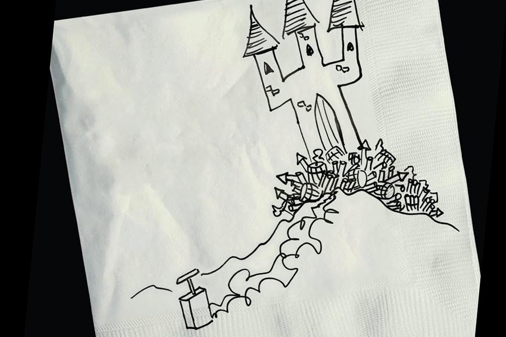 A imagem mostra um guardanapo branco com a ilustração de um castelo cercado de fogos de artifícios ligados a um detonador. A ilustração é feita em caneta preta e o fundo da imagem também é preto.